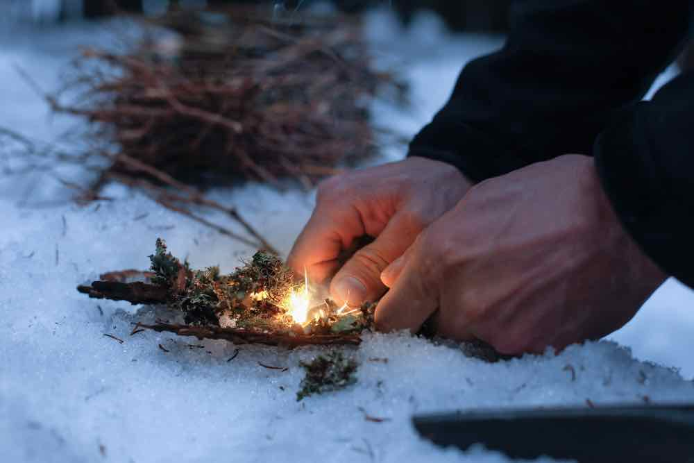 Starting a fire in the snow