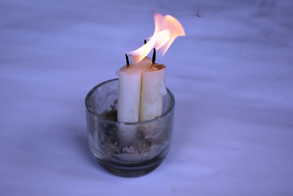 The burn time and brightness of emergency candles differ by size and material.