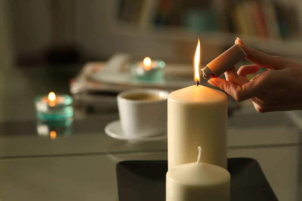 Emergency candles provide heat and light during a power outage