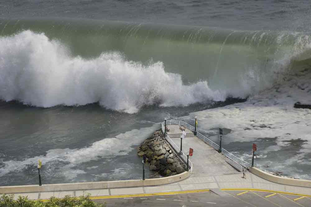 Tsunami waves easily overwhelm sea walls and cause coastal flooding.
