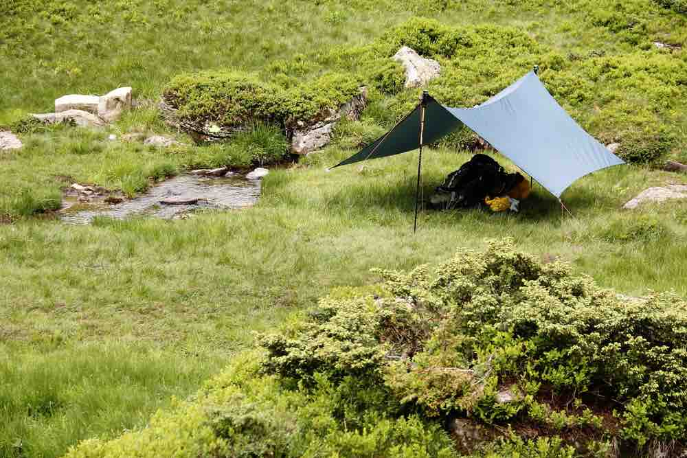 The A-frame benefits from the use of a rope and tarp, or you can make a variation of the shelter.