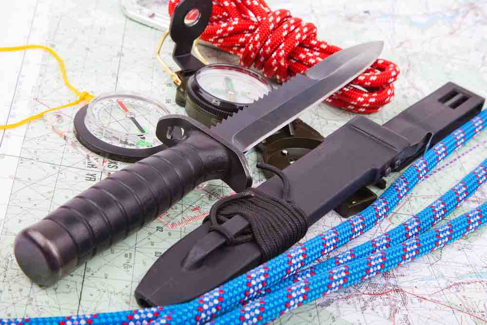 A survival knife is a valued tool in the wilderness along with map, compass, and rope.