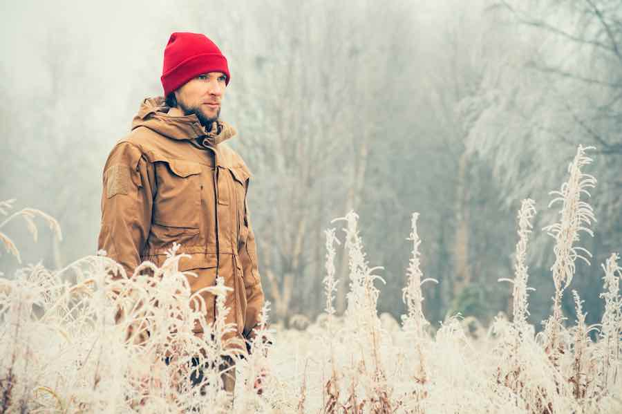 Winter Survival Clothing: Man in Woods