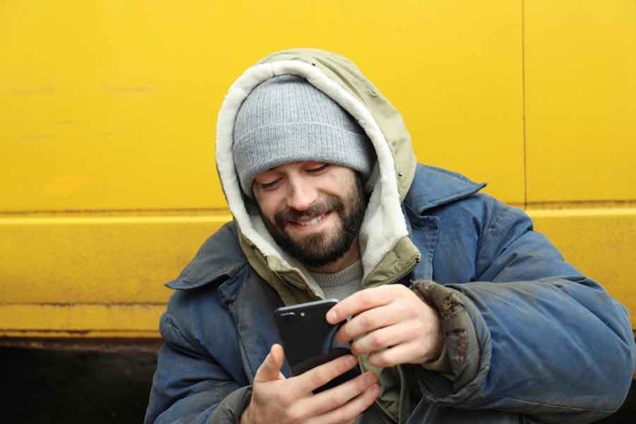 Homeless man with phone