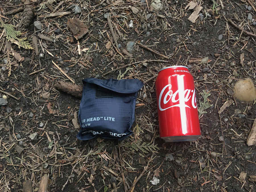 Therm-a-Rest Air Head Lite Pillow in stuff sack near 12oz Coca-Cola can for size