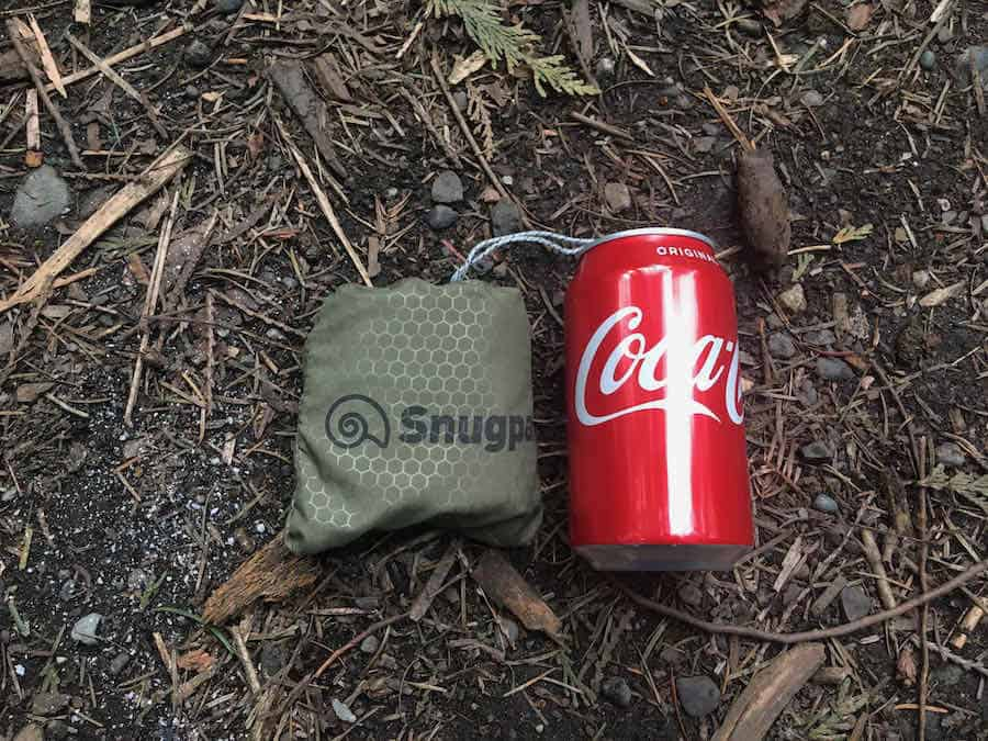 Snugpak Air Pillow next to Coca-Cola