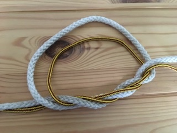 Wrap free end around loop two times to form Surgeon's Knot