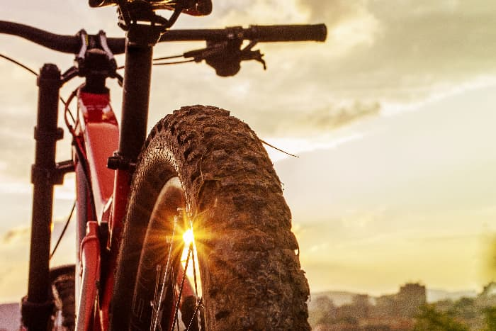 A mountain bike with the sun shining in the background -- mountain bikes are just one option for a bug out bicycle.