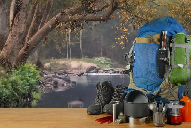 Survivalist-style backpack with various camping and survival supplies.